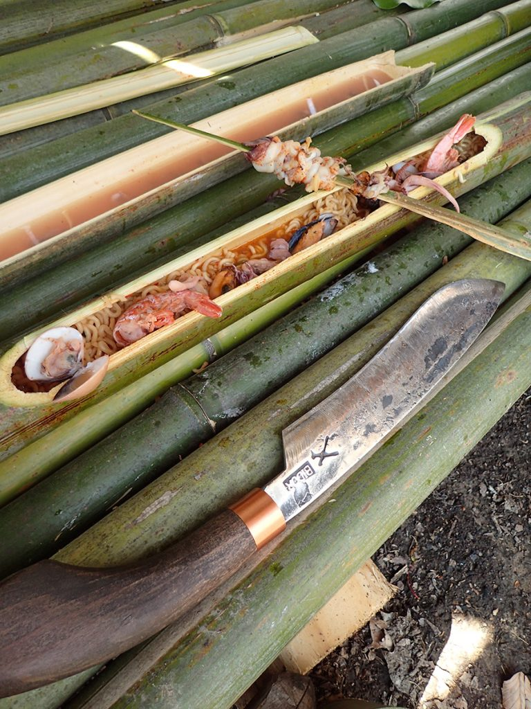 Bamboo cooking tube full of delicious food