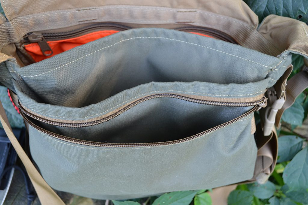 When you open the flap of the Haversack, there's a zippered pocket on the front of the bag. This is perfect for things like map and compass.