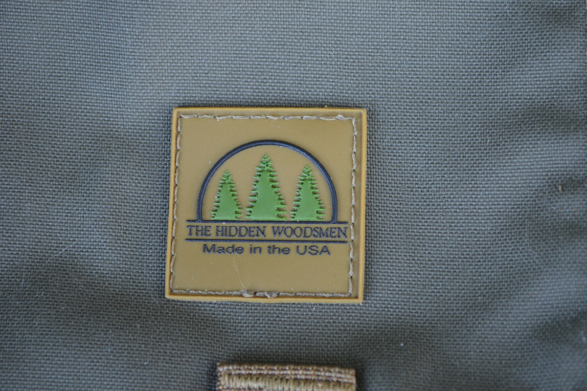 The insignia for The Hidden Woodsmen is stitched to the front flap.