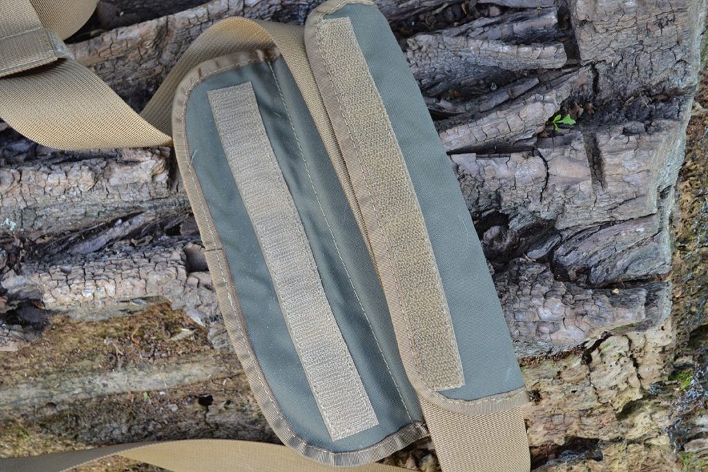 To remove the padded shoulder strap from the Hidden Woodsman Haversack, simply open it via the hook and loop closure.