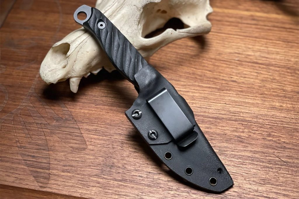 The Half Face Blades Crow Jr. Blade in its sheath. These are not the Christensen Arms/Half Face Blades version. Photo for reference only. Photo: Half Face Blades