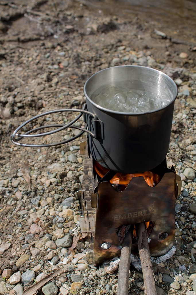 When boiling water to purify, ensure it reaches a temperature of 212° F (208° F at altitudes above 2000 feet). It doesn't hurt to give it a few extra minutes for good measure. The Emberlit Stove is a great way to boil water covertly when necessary.