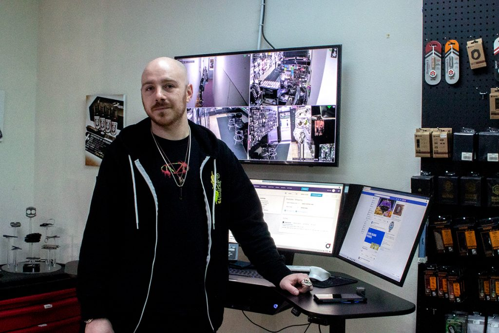 Jeremiah stands in front of the security monitor in the VIP room.