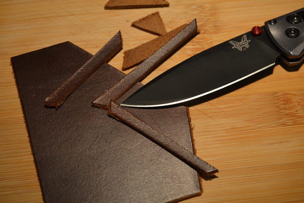 The sharp edge sliced easily through leather.