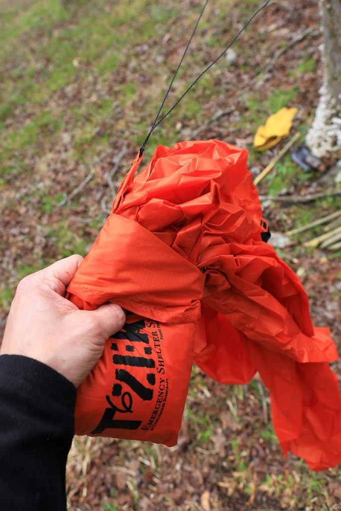 Once the Coalcracker Bushcraft T6ZERO is tied off at one end, walk to the next tree to deploy the tarp. Simple, fast set-up in any emergency or recreational camping.